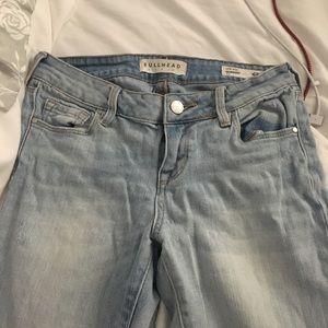 Light wash bullhead low rise skinny jeans